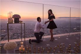 rooftop proposal at sunset