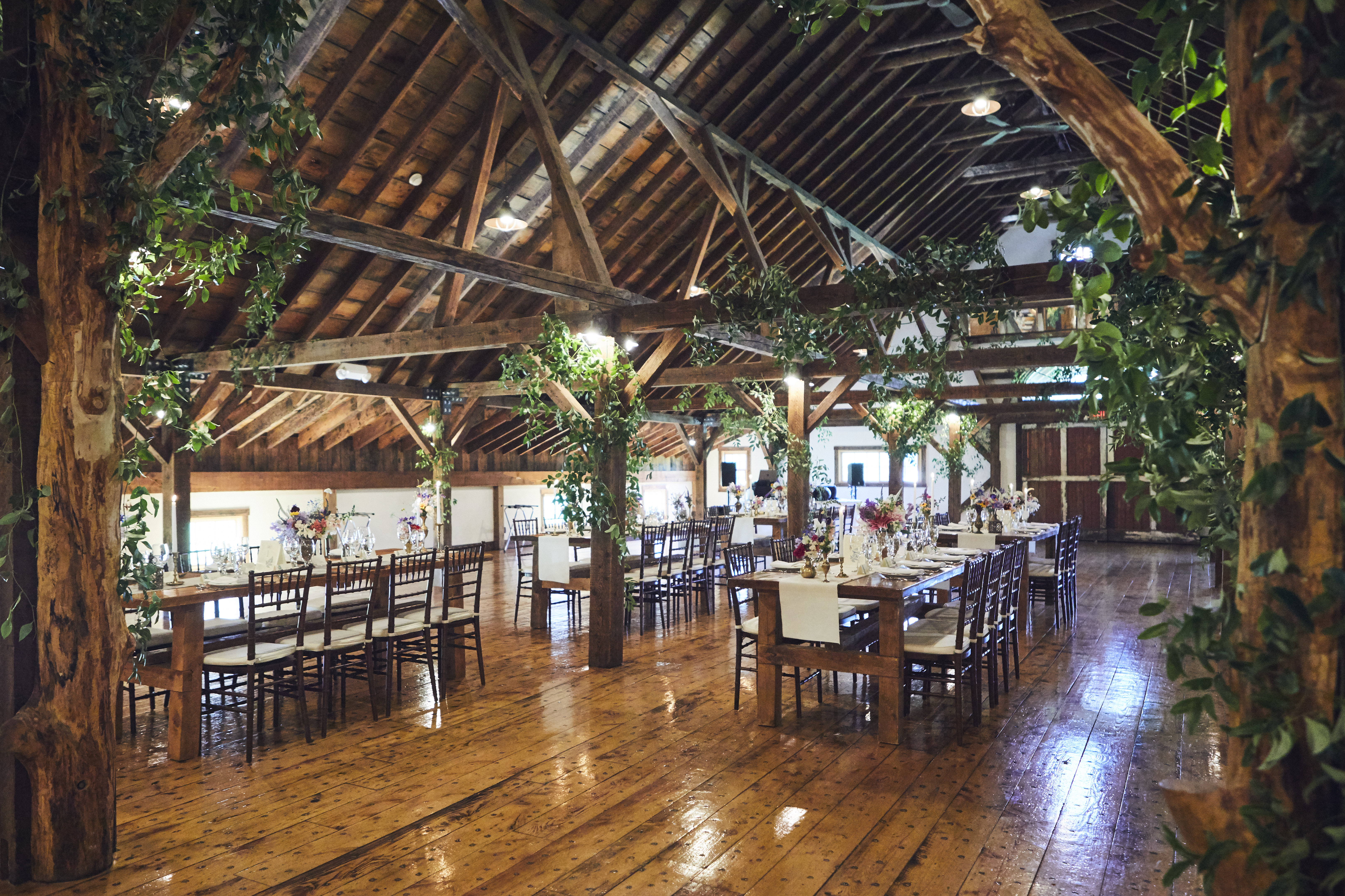 barn filled with tables for reception