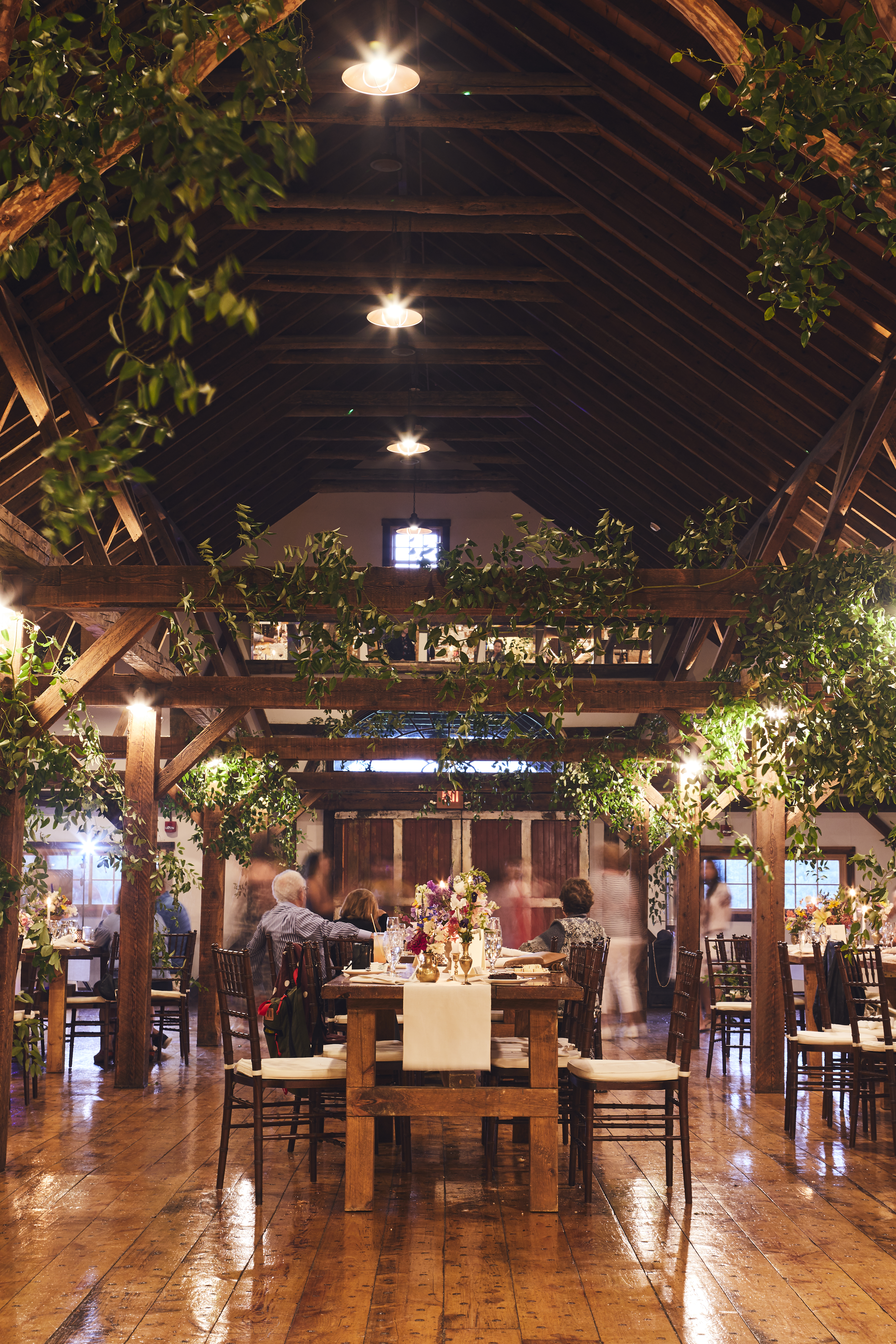 long table in barn with rustic decorations