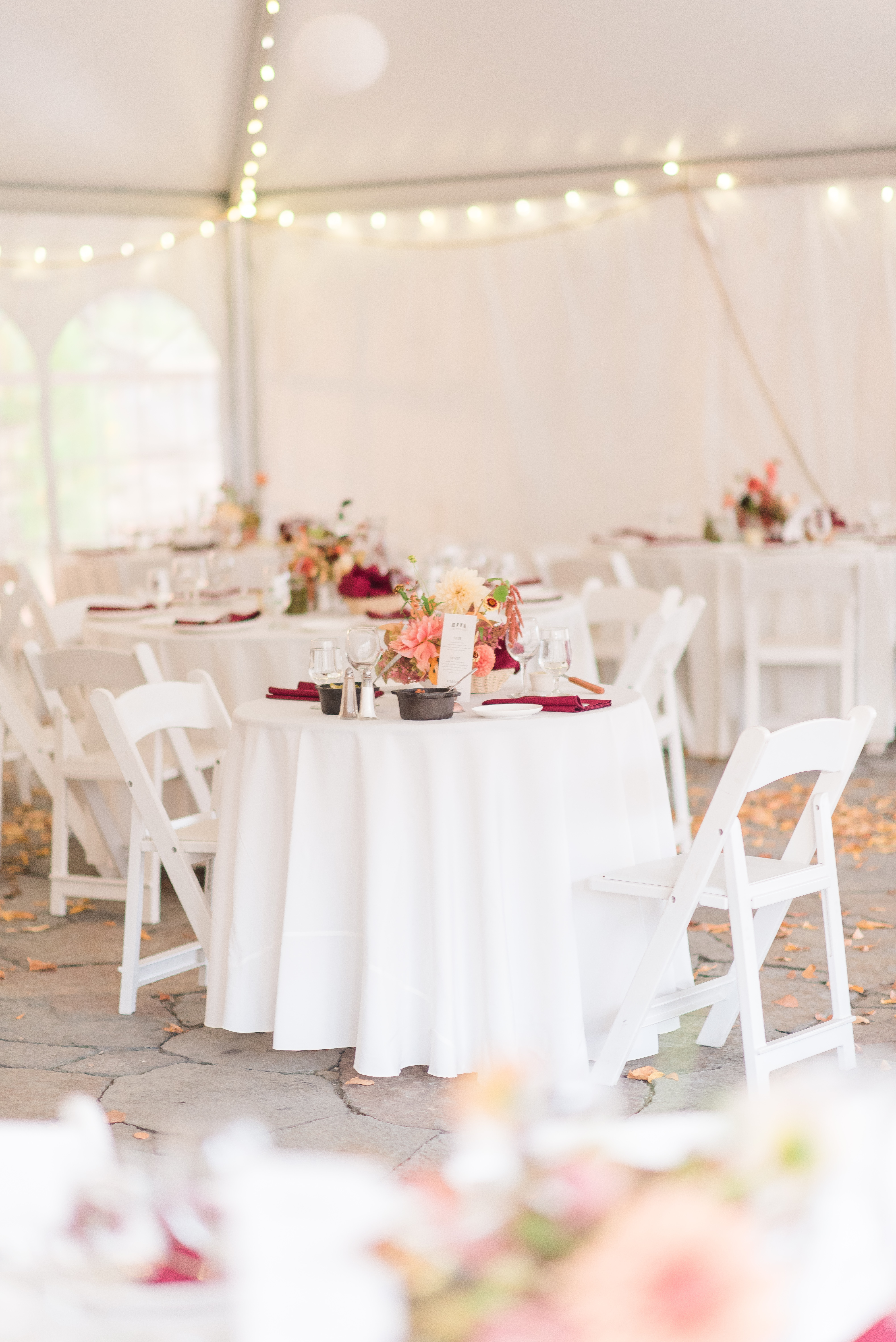 wedding reception in tent with white tables