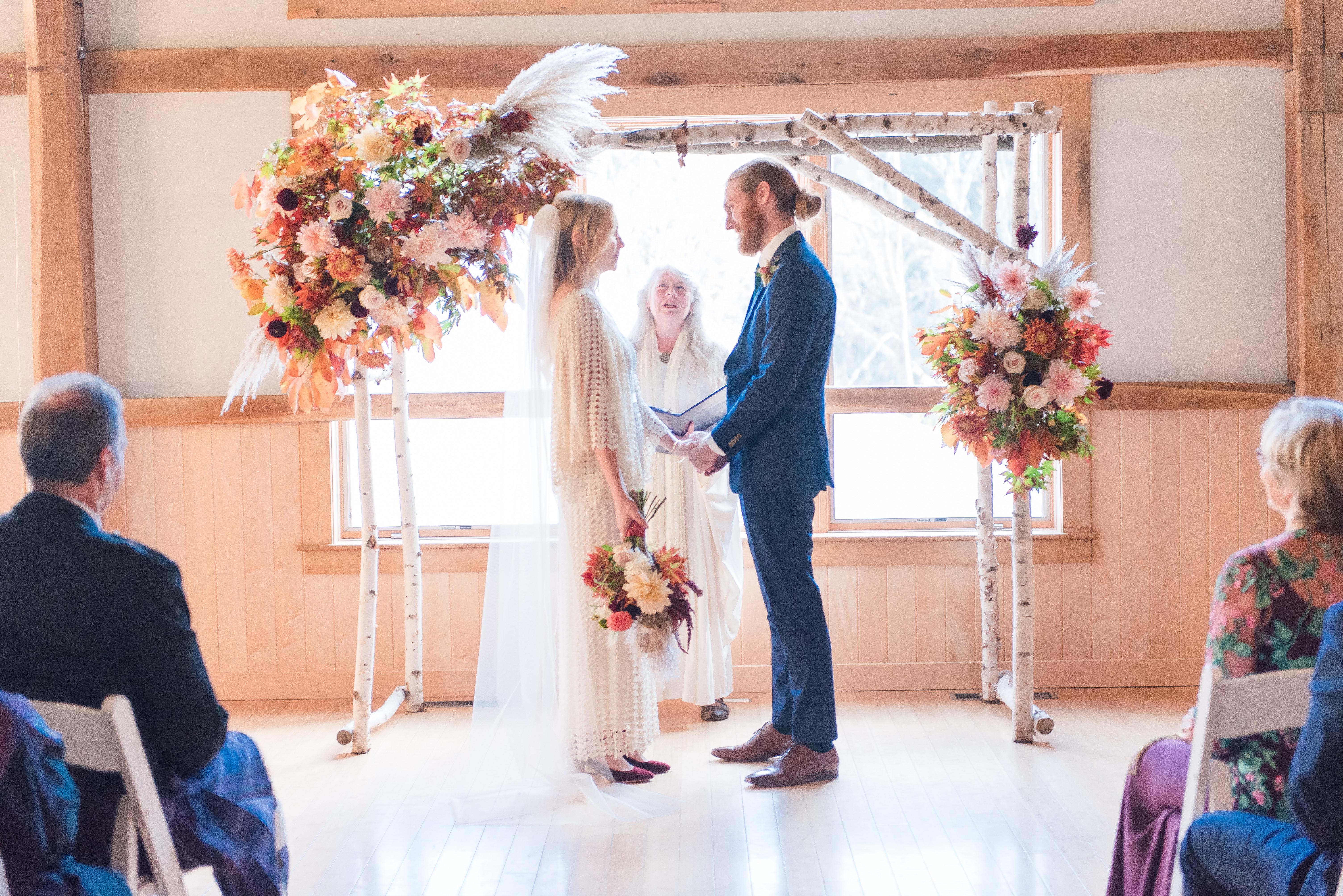 wedding ceremony under arbor